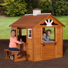 The Summer Cottage Playhouse reminds you of a quaint little place tucked in the woods by a lake - the perfect getaway! It has panelized wood walls made from ced