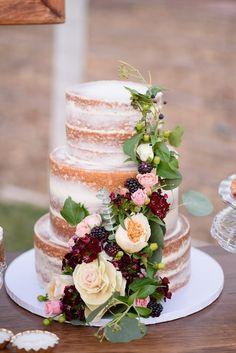 Naked Cake Draped in Flowers & Berries  Pomegranates & Berries, Rustic Glam, Wedding Inspiration Photographer: The Amburgeys