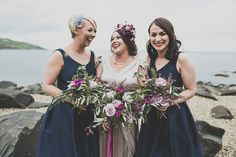 Bridesmaids wear navy blue dresses  | Photography by http://marymcquillanphotography.com/