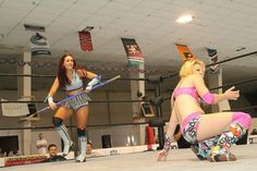 Veda Scott stalking Candice LeRae with a hockey stick. Candice Lerae, Kang The Conqueror, Female Wrestlers, Hockey, Wrestling, Lady, Style, Fashion, Lucha Libre