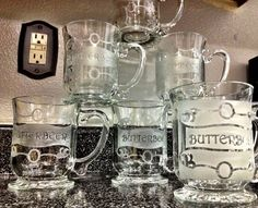 #DIY Butterbeer mugs! (Or any other mugs for that matter) I bought the mugs from Walmart, less than $3 each. I then bought the stencil (click link) , bought etching cream from Michaels and voila! (The one on the right was a test with frosted spray paint)
