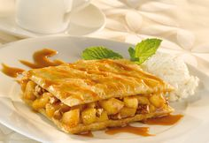 Between two puff pastry rectangles you'll find a mouthwatering mixture of apples sautéed with butter, brown sugar and cinnamon, topped with caramel sauce and chopped pecans. Served warm with vanilla ice cream, you get thewonderful flavor of apple pie without all the work.