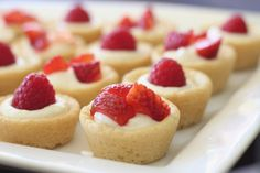 Mini Berry Tarts- Cute little sugar cookie tarts filled with sweetened cream cheese and a berry on top.