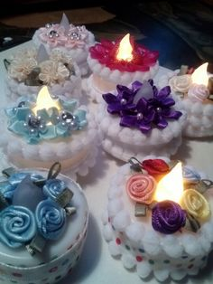 Birthday/Celebration battery tea lights, some with a magnet glued to the bottom. Attach the recipients card to the fridge or file cabinet at work. Would also be great on a cupcake or several of the same design on a full size cake.