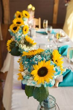 Sunflower Wedding Inspiration- I like this but I'm leaning towards rose colors not blue but who knowsss