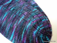 Pattern directions are written for using magic loop, top down, with a heel flap and wedge toe. Stitch pattern is mirrored on the left and right socks. The stitch pattern is fairly easy to remember, making it a great project for on the go knitting.
