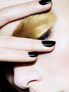 Gold eyeshadow and black nails