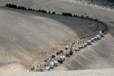 Riders make theiir way up the slopes of Mont Ventoux during stage fifteen of the 2013 Tour de France, a 242.5KM road stage from Givors to Mont Ventoux, on July 14.