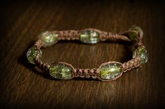 Brown hemp bracelet w/glass beads. SOLD  Email me for more info: dkwilson68@hotmail.com
