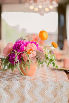 Bright flowers and a chevron sequined tablecloth: http://www.stylemepretty.com/2014/11/10/whimsical-dallas-loft-wedding/ | Photography: Nbarrett - http://nbarrettphotography.com/