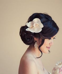 Beautiful white orchids can replace a veil for a modern bride