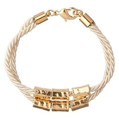 £10.95 - Gold & Cord Mila Bracelet. This Mila bracelet is strung on an ivory white cord, with a double loop and stunning gold-tone beads and details. This bracelet has lobster-clasp fastening for easy fitting and makes the perfect complement to the matching Mila necklace.