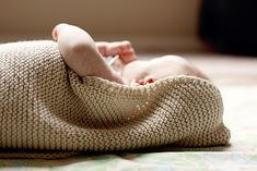 Knit swaddle, with hood. Baby Envelope  by Joanna Johnson, knitting pattern