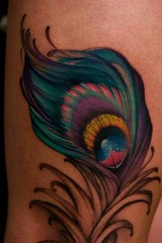 Perfect peacock feather tattoo idea for the lower calf