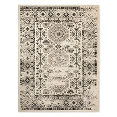 Add vintage appeal to your home with the Ryan Overdyed Rug from Threshold. This throw rug has a distressed, weathered design to give you a comfortable, lived-in feel.