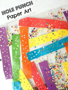 Contact paper hole punch art for kids. A fun paper crafty type activity for toddlers, preschoolers or school aged children. Learn colours too. Great way to create rainbow art and develop fine motor skills. #finemotor #finemotorskills #colours #rainbow #rainbowcolors #rainbowactivities #funforkids #toddlers #activitiesforkids #activities #papercraft #paperart #artforkids #art #kids #holepunch #holepuncher #contactpaper #contact #suncatchers