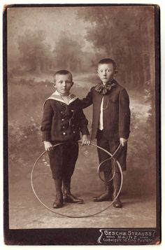 Two children with tennis racket and hula hop. by Photomatika