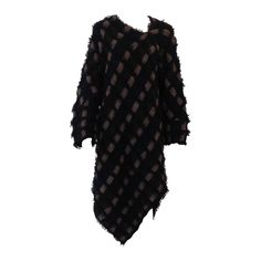 Issey Miyake Neutral Knit Asymmetrical Dress   From a collection of rare vintage day dresses at https://www.1stdibs.com/fashion/clothing/day-dresses/