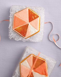 Fancy favors: Jewel-shaped cookies nestled in see-through boxes; we have these boxes at the Essential Packaging Store!