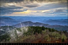 Blue Hour landscape from the Blue Ridge Parkway in western NC. The southern Appalachian Mountains offer stunning scenic landscapes that stretch to the distant horizon, over the peaks and ridges of the Blue Ridge Mountains and Great Smoky Mountains National Park.
