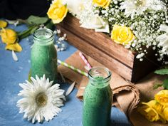 Green smoothie in glass bottles by Life Morning Photography on @creativemarket