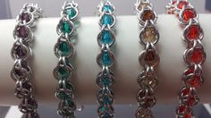 Crystal Bicone beads caged in a chain maille bracelet by JoyasSuri