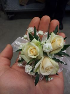 miniature white rose wrist corsage for infant