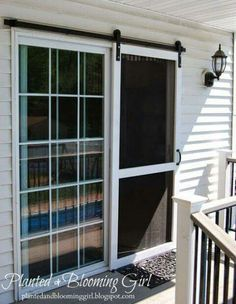 13 Country Chic Ways to Refresh a Screen Door Include some barn style to the back of your home by installing a sliding screen door. Get the tutorial at Planted and Blooming Girl.<br> Because it's not a country house without a screen door. Diy Screen Door, Sliding Screen Doors, Screens For French Doors, Exterior Sliding Doors, French Doors Patio, Rolling Screen Door, Replacement Sliding Screen Door, Exterior French Doors, Farmhouse Patio Doors