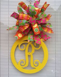 Vine monogram circle measures 12,bow adds an additional 8. I can do any colors. Please specify initial when ordering. Feel free to ask any