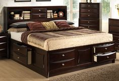 This contemporary bedroom is crafted of solid hard woods with okume veneer in an espresso finish. Bookcase headboard has two storage drawers along with six additional underbed storage drawers. Complete king bed dimensions 79x81x56. Also available in queen size.