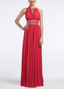 Elegant, fun andabove all comfortable! You will love this gorgeous beaded jersey dress!   Sleevelessbodice featuring eye-catching and chic key hole detail.  Heavily beaded empire waist adds tons of sparkle and helps create a flattering silhouette.  Long jersey skirt with front slit gives this already fabulous ensemble a flowy feel and touch of drama.  Perfect dress for a military ball or any special occasion.  Fully lined. Imported polyester/spandex blend. Hand wash cold. ...