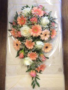 Tear drop bouquet , using Miss piggy roses , judo gerbera , salmon gerbera and avalanche roses.
