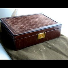 """Reserved Gucci Vintage Leather Jewelry Travel Case Authentic Gucci Vintage Suede/Leather GG Jewelry Travel Case! RARE! This vintage treasure will not be seen again soon! It has a smooth suede top imprinted with the GG logo & suede interior. There's a top protective cloth, which also has a zipper compartment. The ceiling of the case has a puckered pocket & there are several jewelry compartments inside. Opens with a gold GG stamped push-lock. 7"""" x 5"""" x. 2.5"""""""