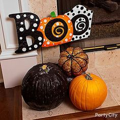 Set Up A Fashion Forward Pumpkin Patch Under Your Mantel This Trio Look Frightfully Diy Ideasdecor