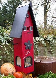 red birdhouse and feeder @Leigh Hustad