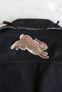 "A leaping rabbit based on an original acrylic painting by Lisa Vanin. Embroidered patch with iron-on backing - slightly larger than our usual patches at 5"" wide. Perfect across the top back or bottom back of a jacket."
