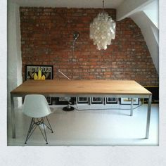 Ethnicraft table brick wall eames chair