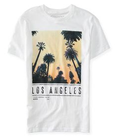 """Soak up all the rays at the sunny coast wearing our Los Angeles Palms Graphic T! The soft, lightweight fabric is printed with palm tree silhouettes set against a vibrant backdrop, while slick """"Los Angeles"""" text adds subtle shine.<br><br>Authentic fit. Approx. length (M): 28.5""""<br>Style: 8185. Imported.<br><br>100% cotton.<br>Machine wash/dry."""