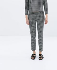 Image 4 of PRINTED ZIP-UP TROUSERS from Zara