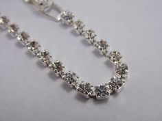 Designer- N/A Size- 6 3/4 Inch Carat Wt- 3ct T.W Features- Prong set Cubic Zirconia Silver tone bracelet Overall Condition- Very good to excellent  Item Notes- Clasp has some surface scratching,minor plating loss All Rhinestones intact and are bright,brilliant, & clear