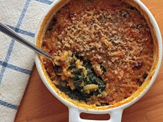 Alice Waters' Swiss Chard Gratin __ Ingredients: 3 bunches CHARD, washed & stemmed (save half the stems);  2 Tbs BUTTER; 1 lrg ONION, diced; SALT to taste; 4 tsp FLOUR; 1 C. MILK; Freshly grated NUTMEG