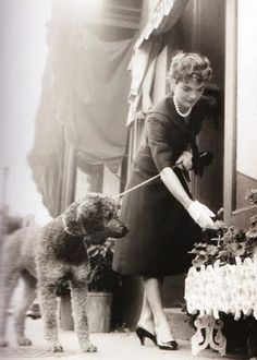"""Jackie Kennedy and her """"phantom"""" colored poodle"""