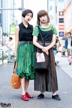 Shino (17) and Aoi (16) are two stylish Japanese students who caught our eye in Harajuku. In addition to school, Aoi is an aspiring dancer who is known in the Tokyo street fashion scene. Shino – on the left with short black hair – is wearing a resale look featuring a sleeveless top, a belted green skirt, and red and black flats. Her leather tote bag is also a resale find. Shino's favorite musical artist is the Japanese psychedelic rock trio Yura Yura Teikoku and she also likes Yogee New…