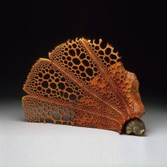 Sea Fan  17″h x 25″w x 6″,  Maple Burl, African Padauk stand     by Mark Doolittle who holds a Ph.D in cell and molecular biology. The California woodworker pursued a career in biomedical research at the same time he developed an interest in art.