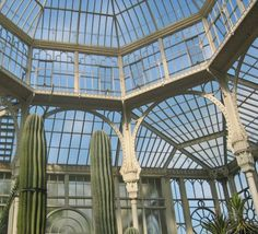This magnificent iron & antique glass conservatory is located in the Wilhelma Botanical Gardens in Stuttgart, Germany. The mid-19th century building was once part of the royal palace located on the grounds, and is built in the Moorish Revival style.
