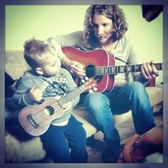 #TBT to that one time I melted when Nick taught my sweet nephew baby Chase how to play his Blem Blem (what he calls a Uke). #family #nickandpaige #nephew #uke