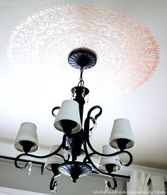 note the treatment on the ceiling.  This could be an interesting option for contrast on your ceiling...if you do the metallic paint, this would be a matte finish.  If you were skittish about doing the entire ceiling in metallic, you could do  just this!