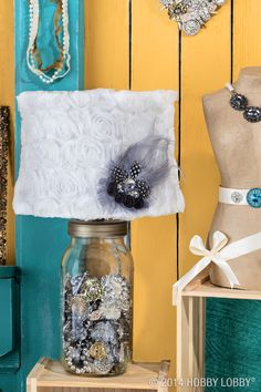 A Mason jar becomes a luminary objet d'art when it's filled with baubles and brooches, outfitted with a Mason jar lamp kit (Home Décor Department) and topped with a feathered shade. Talk about a lamp revamp!