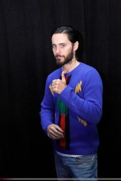 Jared Leto wearing Vans Classic Slip-on in Black and White Checker and Gucci Bee Jacquard Wool Sweater