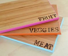 three bamboo cutting boards with words burned into the surface. Cute  Functional: 5 DIY Projects That Look Good  Make Life Better